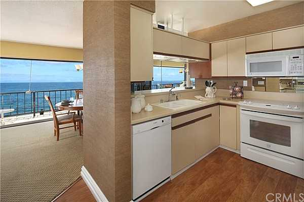 Photo #9 Ocean view kitchen and dining area.
