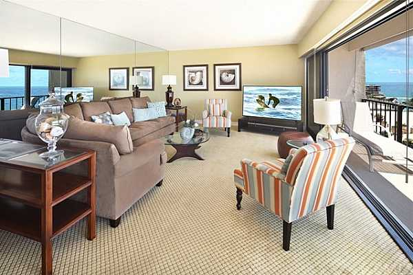 Photo #8 Ocean view living room with new sliding doors. Opens to deck breezes and view.