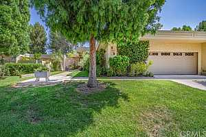 Browse active condo listings in LAGUNA WOODS VILLAGE
