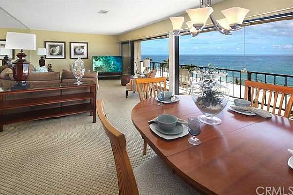 Photo #7 Dining and Living Rooms open to the ocean views and breezes.