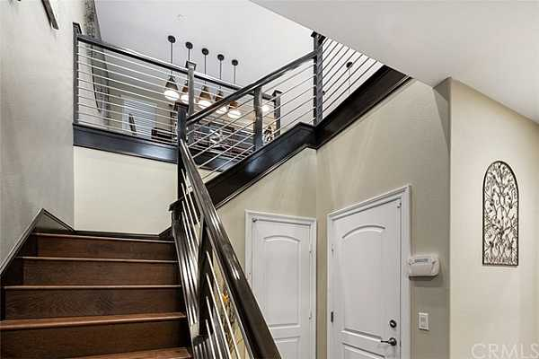 Photo #3 First Floor entry with stairs up to living areas